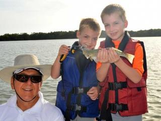 Grandpa Fishing With His Grand Kids In Fort Myers